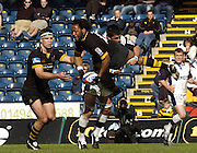 2005 Zurich Premiership Wild Card Play off London Wasps vs Sale Sharks, High Wycombe, ENGLAND: Wasps Joe Mbu is up ended by Sharks John Carter left Joe Worsley looks on.  .Photo  Peter Spurrier. .email images@intersport-images...