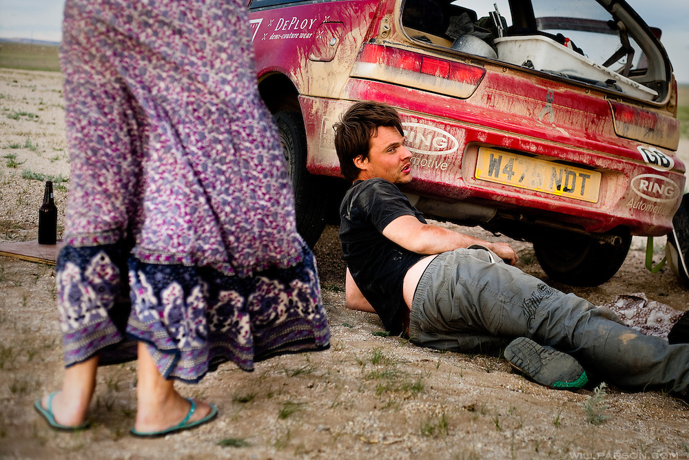 Alec and his girlfriend Emma would not drive their car again after realizing that a concoction of bubble gum, silicone and liquid metal donated from other teams had failed to patch a large hole leaking oil west of Bayan-Khongor, Mongolia. The British couple received a tow to Ulaanbaatar and were able to donate the car.
