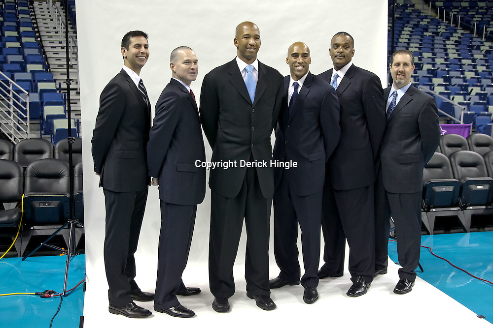 Sep 27, 2010; New Orleans, LA, USA; New Orleans Hornets coaches (left to right) James Borrego, Michael Malone, head coach Monty Williams, Fred Vinson, Randy Ayers, and Bryan Gates pose during media day at the New Orleans Arena. Mandatory Credit: Derick E. Hingle