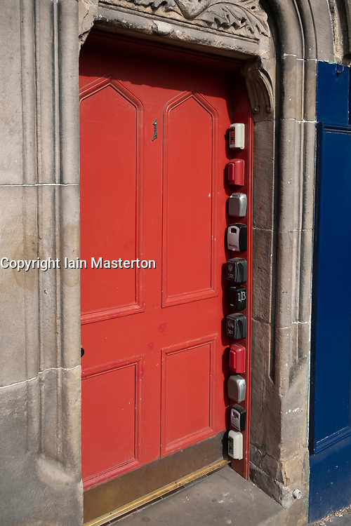 Detail of many short term letting key boxes fixed illegally to block of flats in Edinburgh Old town , Scotland, UK, These are used by companies such as Airbnb.