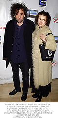 Actress HELENA BONHAM-CARTER and TIM BURTON, at a party in London on 26th November 2002.	PFP 235