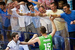 Gezim Morina of Slovenia celebrates with his fans after winning the basketball match between National teams of Turkey and Slovenia in Qualifying Round of U20 Men European Championship Slovenia 2012, on July 17, 2012 in Domzale, Slovenia. Slovenia defeated Turkey 72-71 in last second of the game. (Photo by Vid Ponikvar / Sportida.com)