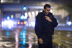 © Licensed to London News Pictures . 20 December 2013 . Manchester , UK . The Inspector uses his radio during a stop on a vehicle in the rain . A Mad Friday shift with Inspector Matt Bailey-Smith , of Greater Manchester Police's ANPR and Tactical Vehicle Intercept Unit . Photo credit : Joel Goodman/LNP