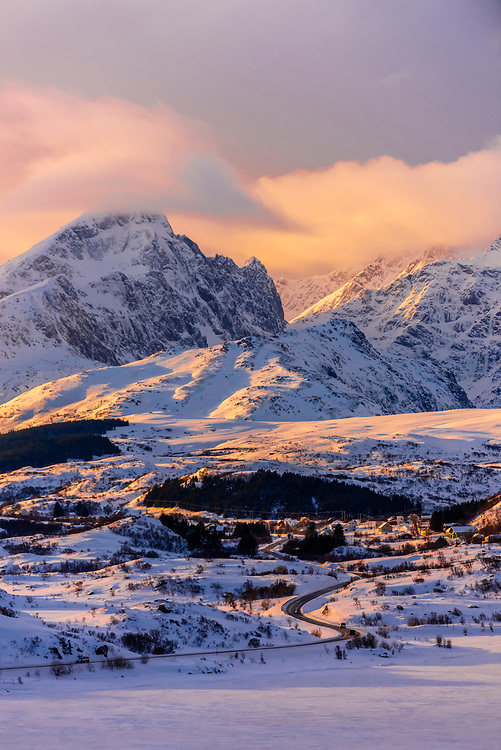 Snow covered landscape on Vestvagoya Island with the main highway E10 in the middle, Lofoten Islands, Arctic, Northern Norway.