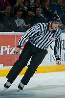 KELOWNA, CANADA - FEBRUARY 9: A WHL official skates with the puck on February 9, 2015 at Prospera Place in Kelowna, British Columbia, Canada.  (Photo by Marissa Baecker/Shoot the Breeze)  *** Local Caption *** officials; lineman;
