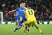AFC Wimbledon striker Cody McDonald (10) battles for possession with Michel Vorm of Tottenham Hotspur (13)  during the The FA Cup 3rd round match between Tottenham Hotspur and AFC Wimbledon at Wembley Stadium, London, England on 7 January 2018. Photo by Matthew Redman.