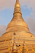 Monks walking high up on the Shwedagon Pagoda, Yangon, Myanmar.