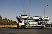 Supplier truck transporting new cars to a distribution centre