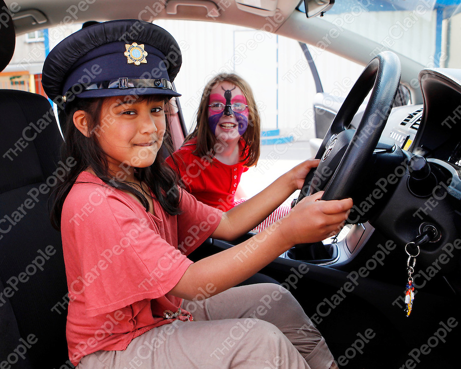 27/05/12<br /> Nabila Nusrat and Sinead Flannery pictured trying out a Garda Car at CBS Primary School Garden Fete in Ennis on Sunday.<br /> Picture: Don Moloney / Press 22