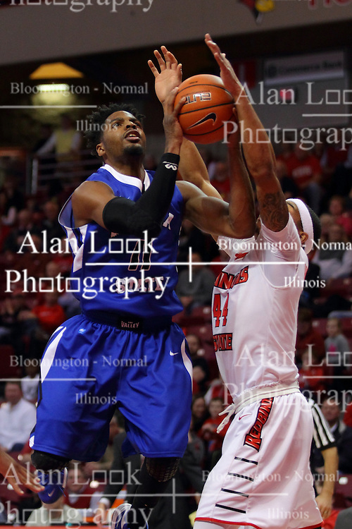 17 February 2016: DeVaughn Akoon-Purcell(44) gets an arm on the ball during a shot by Devonte Brown during the Illinois State Redbirds v Indiana State Sycamores at Redbird Arena in Normal Illinois (Photo by Alan Look)