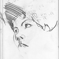 Sketchbook drawing of young woman's face close up