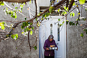 Androniki (72) who is living in the small Crete mountain village of Rodovani serving coffee for her guests.