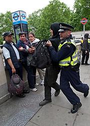 © London News Pictures. 11/06/2013. London, UK. Scuffles break out in the streets surrounding a squat at an abandoned police station on Beak Street, London which is being used by Anti-G8 activists as their headquarters ahead of a demonstration in central London today (Tues) The G8 Summit is due to take place in Norther Ireland early next week. Photo credit: Ben Cawthra/LNP