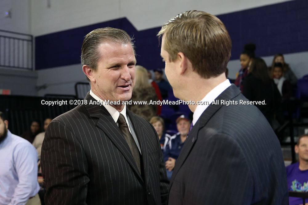 HIGH POINT, NC - JANUARY 06: Charleston Southern head coach Barclay Radebough (left) and High Point head coach Scott Cherry (right) meet before the game. The High Point University of Panthers hosted the Charleston Southern University Buccaneers on January 6, 2018 at Millis Athletic Convocation Center in High Point, NC in a Division I men's college basketball game. HPU won the game 80-59.