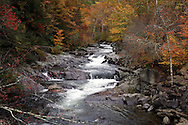 Autumn colors and a rushing stream in the Great Smoky Mountains National Park near Gatlinburg, Tennessee