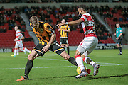Michael O'Connor (Port Vale) stops Cedric Evina (Doncaster Rovers) from getting past him and into the box during the Sky Bet League 1 match between Doncaster Rovers and Port Vale at the Keepmoat Stadium, Doncaster, England on 26 January 2016. Photo by Mark P Doherty.