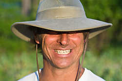 Portrait of man wearing a hat with an over exaggerated smile