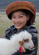 Tibetan girl, Napa Lake, Yunnan province, China