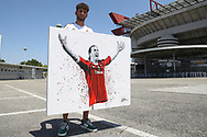 A Milan fan holds aloft a painting of Zlatan Ibrahimovic by the Napoletan artist Vincenzo Lamagna before the Serie A match at Giuseppe Meazza, Milan. Picture date: 28th June 2020. Picture credit should read: Jonathan Moscrop/Sportimage