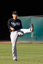 June 29, 2011; Oakland, CA, USA; Florida Marlins second baseman Omar Infante (13) warms up in the outfield before the game against the Oakland Athletics at the O.co Coliseum.  Florida defeated Oakland 3-0.