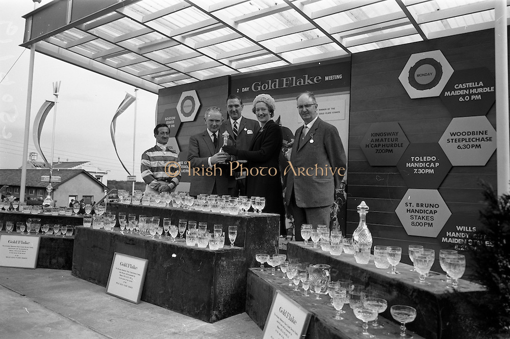 08/05/1965<br /> 05/08/1965<br /> 08 May 1965<br /> The 1965 Gold Flake Meeting at Leopardstown Racecourse, Co. Dublin. Image shows Mrs D.R. Mott, wife of the Managing Director of Wills of Dublin and Cork, presenting the Trophy  for the Wills Gold Flake Stakes to Mr M.V. (Vincent) O'Brien, Trainer, who accepted it on behalf of the Countess de la Valdeme, who's &quot;Donato&quot; won the race. Also in the picture are (from left) Jack M. Purtell (Jockey) Mr. D.R. Mott and Mr Fred Clarke, Managing Director of Leopardstown Club. Note the Waterford Glass Crystal Service sets presented to the winning owner, trainer and jockey.
