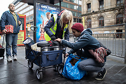 © Licensed to London News Pictures . 25/12/2018 . Manchester , UK . Volunteers for Homeless Project Manchester hand out warm clothes , hot drinks and presents to people found sleeping rough . Homeless people sleeping rough on the streets of Manchester City Centre on Christmas Day . Photo credit : Joel Goodman/LNP