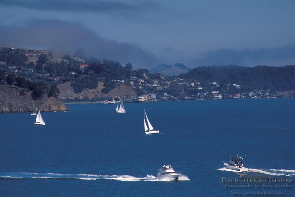 Fog over Boats sailing on San Francisco Bay on a clear blue sky day, Marin County, California
