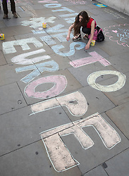 © Licensed to London News Pictures. 21/06/2016. London, UK. An activist chalks a Yes to Europe slogan on the pavement  at a Remain campaign event in Trafalgar Square organised via Facebook. There are only two full days of campaigning ahead of the UK EU referendum taking place on Thirsday 23rd June, 2016. Photo credit: Peter Macdiarmid/LNP