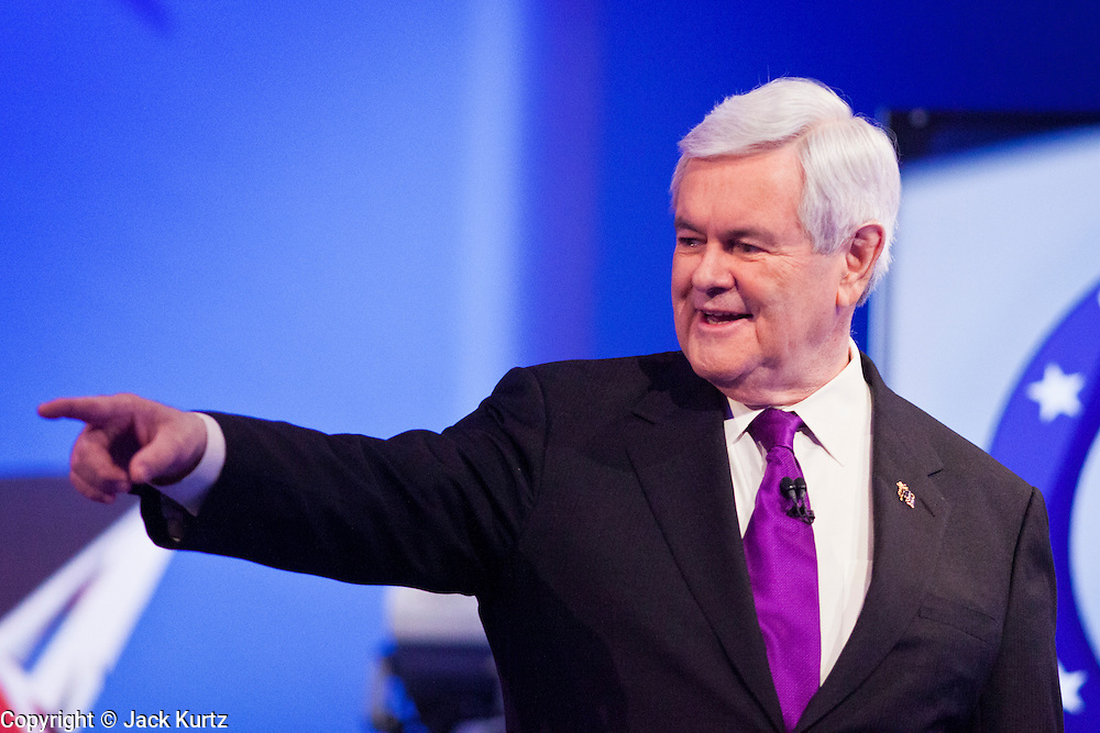 """22 FEBRUARY 2012 - MESA, AZ:      Congressman NEWT GINGRICH walks into the hall at the Arizona Republican Presidential Debate in the Mesa Arts Center in Mesa, AZ, Wednesday. It is the last debate before the Michigan and Arizona Republican primaries on Feb. 28 and """"Super Tuesday"""" on March 6.      PHOTO BY JACK KURTZ"""