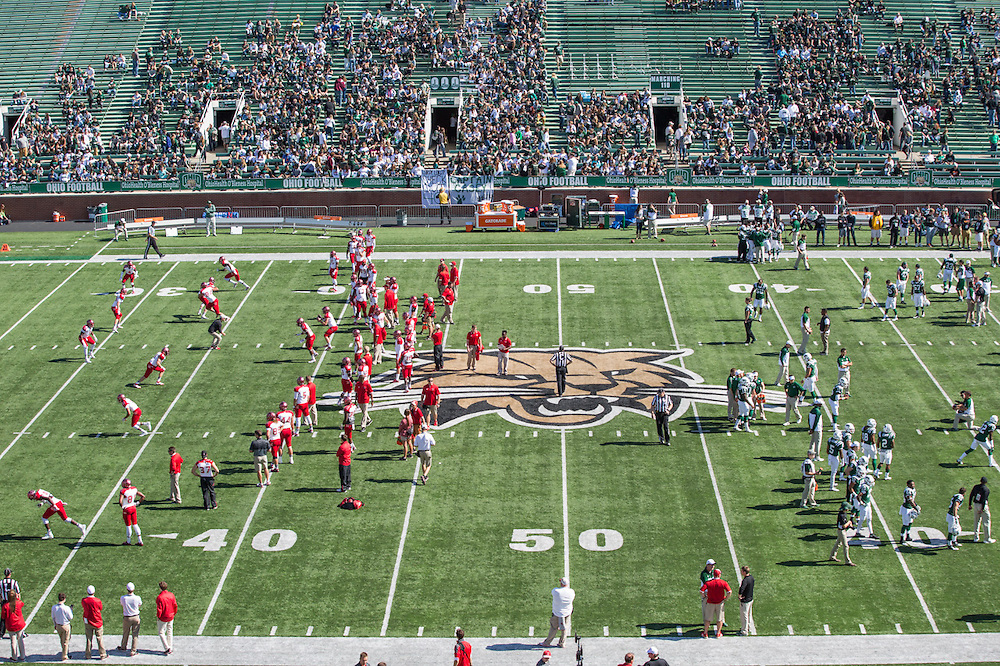 Miami University and Ohio University football teams warm-up before the Ohio University Homecoming game on October 10, 2015 at Peden Stadium. OU won 34-3. Photo by Emily Matthews