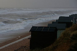 © Licensed to London News Pictures. 06/01/2014, Milford on Sea, UK. Waves batter the coast at Milford on Sea, England , Monday, Jan. 6, 2014. Part of UK continue to be affected by floods and strong wind. Photo credit : Sang Tan/LNP