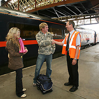 Perth Rail Staff Deal with people travelling to T in the Park. 7-9 July 2007.<br /> Jamie Dryden and Donna Hutton from Inverness are greeted by Scotrail employee Roy Hutton.<br /> Picture by Graeme Hart.<br /> Copyright Perthshire Picture Agency<br /> Tel: 01738 623350  Mobile: 07990 594431