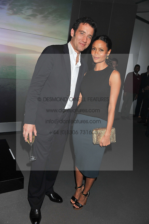 CLIVE OWEN and THANDIE NEWTON at the Global Launch of Audi's first Digital Showroom, 74-75 Piccadilly, London on 16th July 2012.