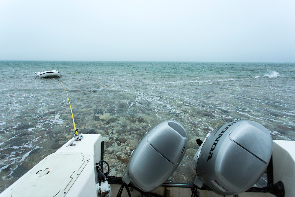 Canada, Manitoba, Cape Churchill, C-Dory boat grounded on offshore reef at low tide during summer storm