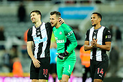 Match winning goal scorer Federico Fernandez (#18) of Newcastle United celebrates with Martin Dubravka (#1) of Newcastle United following the Premier League match between Newcastle United and Southampton at St. James's Park, Newcastle, England on 8 December 2019.