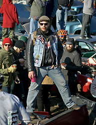 Philadelphia, PA, USA - December 21, 2014; Each year a group cycling enthusiasts converge on a junkyard in North Philadelphia to race each other on dirt paths winding between junk cars at the annual Bilenky Cyclocross event.<br /> <br /> Participants race on all sorts of bikes, including homemade &quot;funnies,&quot; over a course that takes them under, over and around vehicles parked on the junkyard. The venue is between the railroad tracks and the bicycle factory of Bilenky Cycle Works in North Philadelphia.<br /> <br /> For a recap of the event check the photo-essay I made on assignment for WHYY's Viewfinders' blog on NewsWorks.org:<br />  http://www.newsworks.org/index.php/viewfinders/item/76577-bicycle-racers-take-on-a-north-philly-junkyard