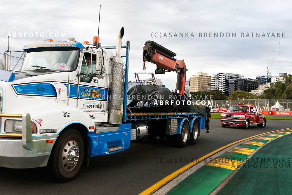 Mercedes driver Valtteri Bottas of Finland car on the back of a tow truck following a serious crash at turn 2 on Saturday during Qualifying for the 2018 Rolex Formula 1 Australian Grand Prix at Albert Park, Melbourne, Australia, March 24, 2018.  Asanka Brendon Ratnayake