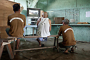 "Minimum security inmates relaxing at the "" game "" center of the prison, jan 2012."