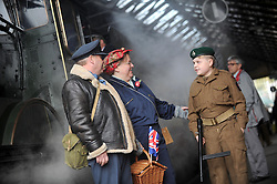 © Licensed to London News Pictures. 12/10/2014. Pickering, UK The annual wartime weekend in Pickering, North Yorkshire. People dress in 1940s period themed outfits and attend parades through the small Yorkshire town which has a traditional steam railway as would have been used in the 1940s. // Pictured:   (l-r) Chris, Rachel and Alexander Johnson on Pickering station platform.. Photo credit :  HARRY ATKINSON/LNP