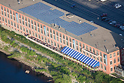 Wood Mill in the process of being converted into New England's largest eco-luxury development with solar panels on the rooftop.