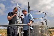 Israel, Recanati Winery. The vintner tastes the wine from the fermentation vat