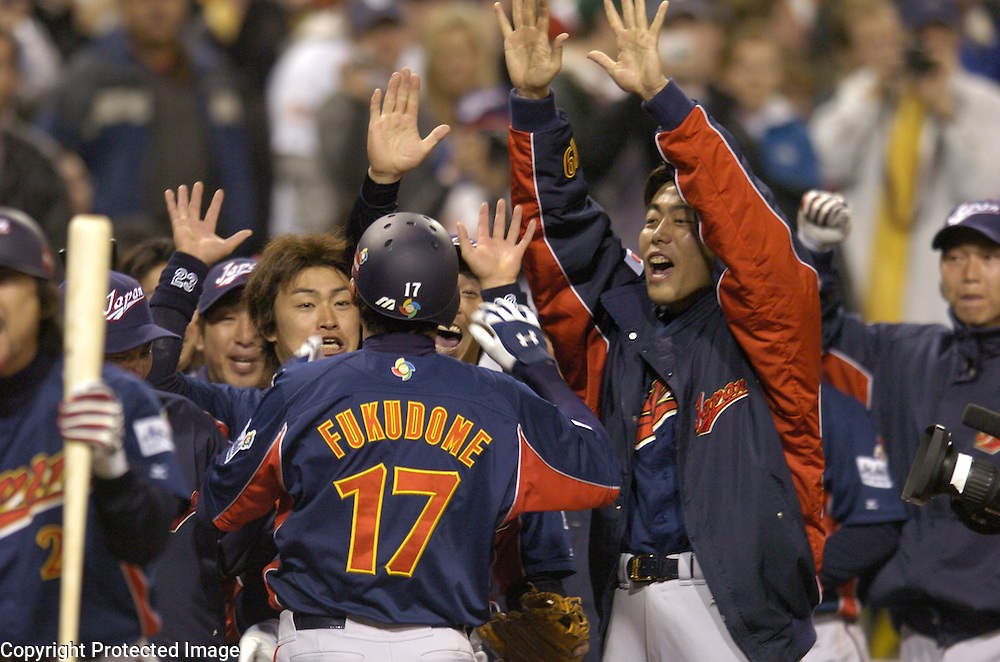 Team Japan celebrates #17 Daisuke Fukudome's 2-run home run in the 7th inning against Team Korea in Semi-Final action of the World Baseball Classic at PETCO Park, San Diego, CA.