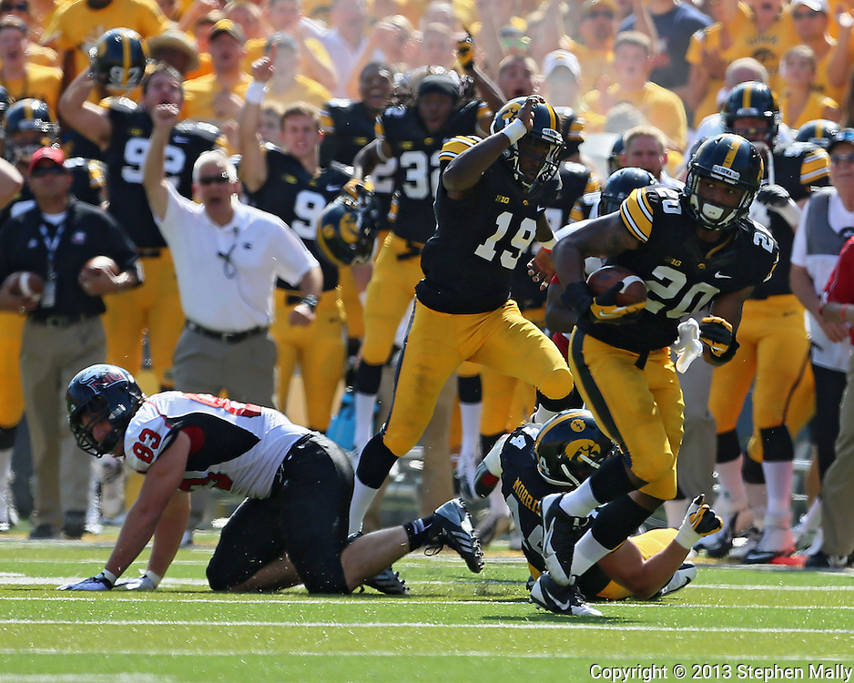 August 31 2013: Iowa Hawkeyes linebacker Christian Kirksey (20) runs with the ball after a fumble by Northern Illinois Huskies tight end Luke Eakes (83) during the first quarter of the NCAA football game between the Northern Illinois Huskies and the Iowa Hawkeyes at Kinnick Stadium in Iowa City, Iowa on August 31, 2013. Northern Illinois defeated Iowa 30-27.