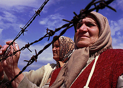 Ethnic Albanian refugees from Kosovo wait for relatives to arrive at the Stenkovec camp near Skopje,  Macedonia, Monday April 12, 1999. Many more refugees flooded the camp today thinking that if they left host families and registered here, they would be able to leave the country. (Photo by Ami Vitale)
