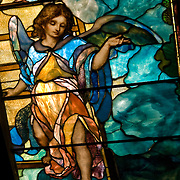 Close up of interior of stained glass angel, in Grace Church New York City.