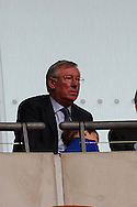 Sir Alex Ferguson looks on during the Johnstone's Paint Trophy Final match at Wembley Stadium, London<br /> Picture by David Horn/Focus Images Ltd +44 7545 970036<br /> 30/03/2014