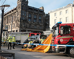 Traffic Accident, Princes Street, Edinburgh, Thursday 5th January 2017<br /> <br /> A pedestrian was knocked down and trapped under a taxi at lunchtime today in the east end of Princes Street, Edinburgh<br /> <br /> Police, Fire and Ambulance services all attended to attempt to release the person from under the taxi. <br /> <br /> (c) Alex Todd | Edinburgh Elite media