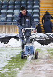 A groundsman chalks the lines on the pitch - Photo mandatory by-line: Matt McNulty/JMP - Mobile: 07966 386802 - 17.01.2015 - SPORT - Football - Rochdale - Spotland Stadium - Rochdale v Crawley Town - Sky Bet League One