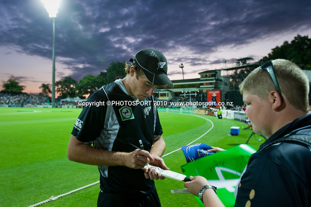 Tim Southee signs autographs on the boundary during the third one day Chappell Hadlee cricket series match between New Zealand Black Caps and Australia at Seddon Park, won by Australia by 6 wickets in Hamilton, New Zealand. Tuesday 9 March 2010. Photo: Stephen Barker/PHOTOSPORT