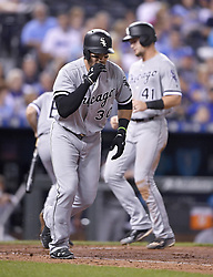 September 11, 2017 - Kansas City, MO, USA - Chicago White Sox's Nicky Delmonico heads to first as Adam Engel scores on a bases loaded walk by Kansas City Royals starting pitcher Jason Hammel in the fourth inning during Monday's baseball game on Sept. 11, 2017 at Kauffman Stadium in Kansas City, Mo. (Credit Image: © John Sleezer/TNS via ZUMA Wire)
